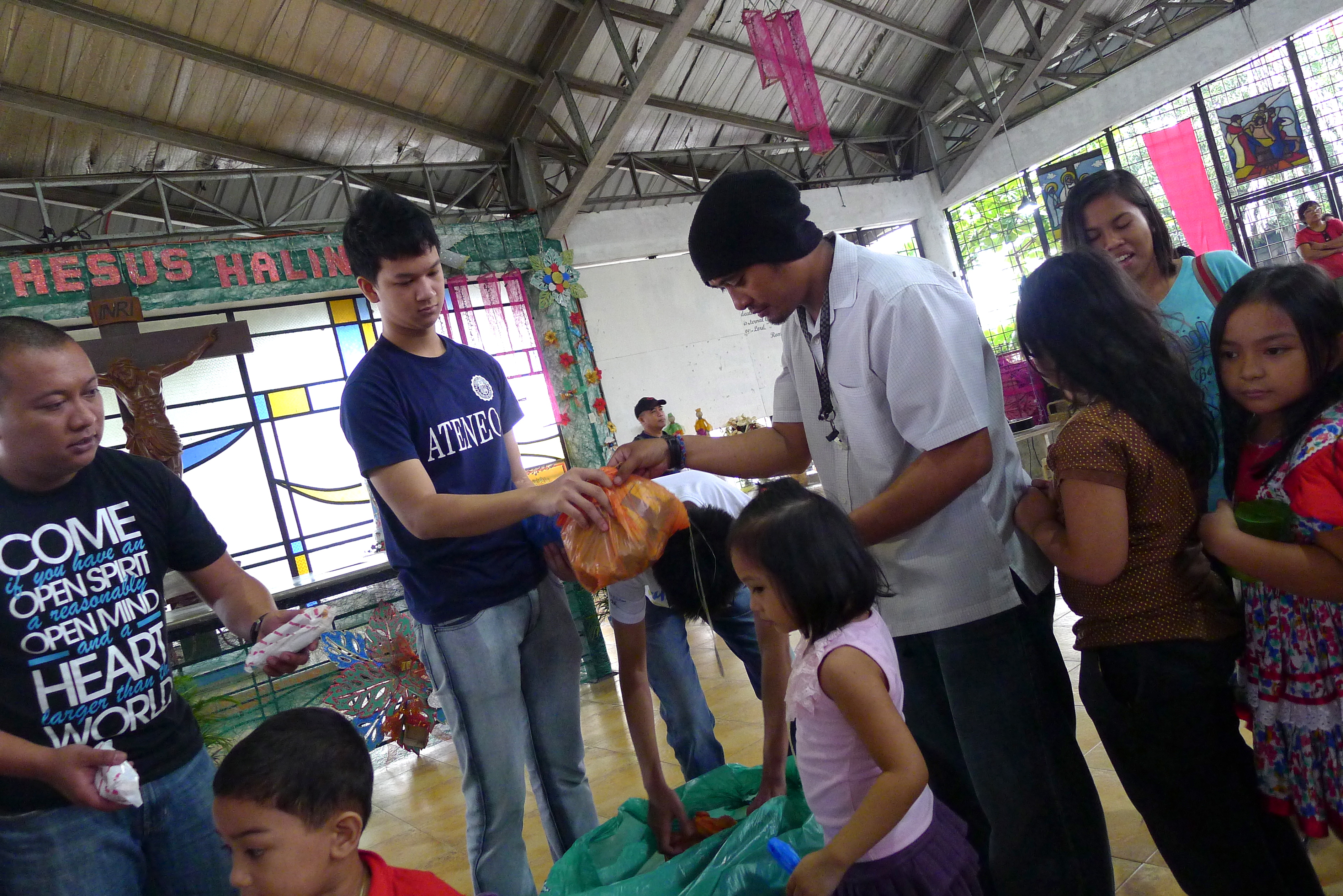 Students giving their Christmas presents to the community of Montalban, Rizal.