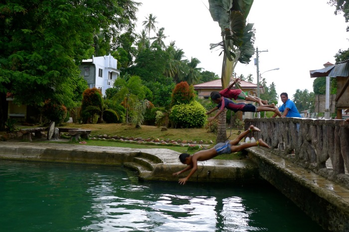Children dive into the cool spring waters of Capilay Spring Park to escape from the summer heat. Photo by: Fr. Jboy Gonzales SJ