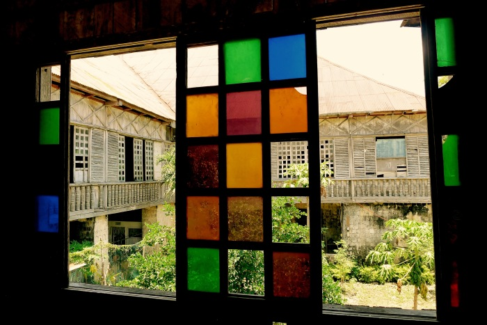 The Lazi Convent is U-shaped which you can see through this colored glass windows. Photo: Fr. Jboy Gonzales SJ