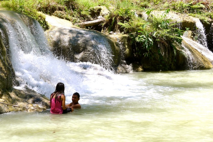 Lovers bathe at the 2nd tier of the Cambugahay Falls, Lazi, Siquijor. Photo: Fr. Jboy Gonzales SJ