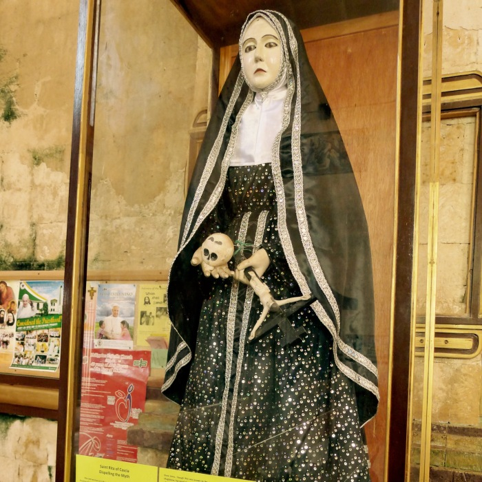 "The note below the image says, ""Dispelling the Myth"" of Sta. Rita de Cascia. Photo: Fr. Jboy Gonzales SJ"