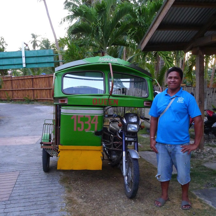 Siquijor's local government empowered tricycle drivers to be tourist guides. This is Roland Borja (Mobile: 0926-8061594). Promote them to others to help them out.