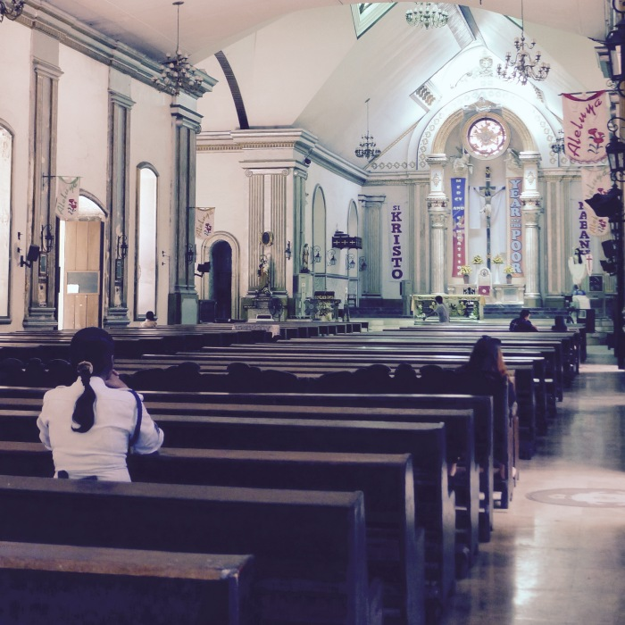 A security guard prays fervently at the St. Catherine the Great Cathedral, Dumaguete City. Photo: Fr. Jboy Gonzales SJ