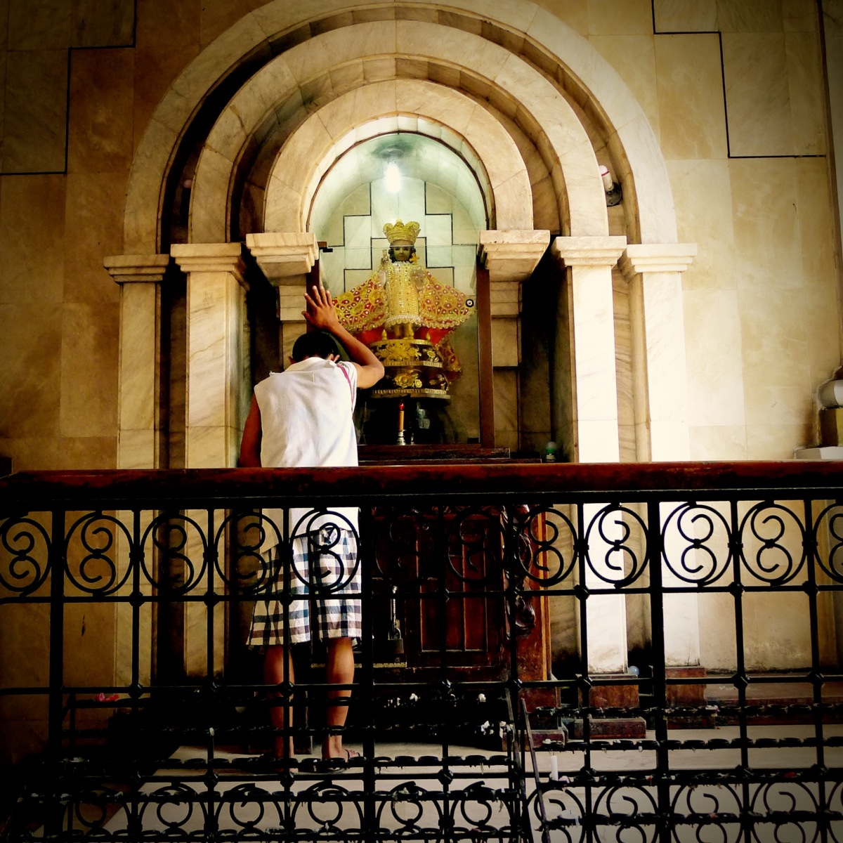 A man prays to the Sto. Nino de Cebu at the St. Catherine the Great Cathedral, Dumaguete City. Photo: Fr. Jboy Gonzales SJ