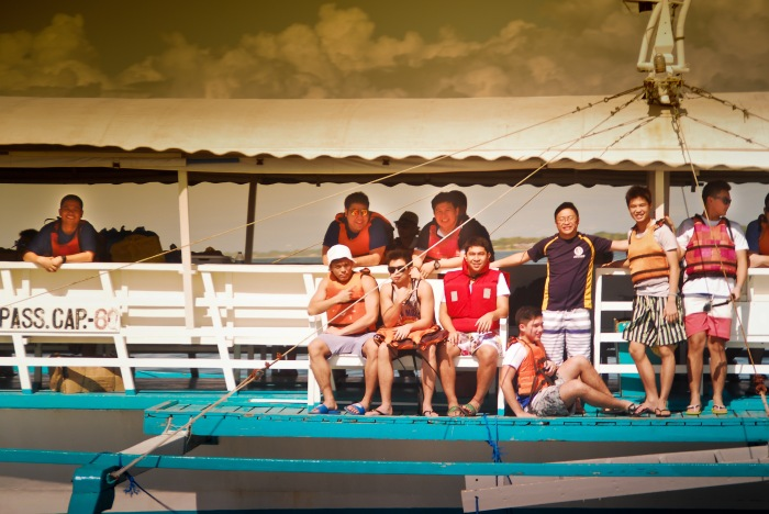 Some boys really enjoyed being at the periphery of the boat. The sea was come anyways. Eco-Spiritual Pilgrimage. Ateneo High School. Photo: Mr. Bok Pioquid, CSIP, AHS