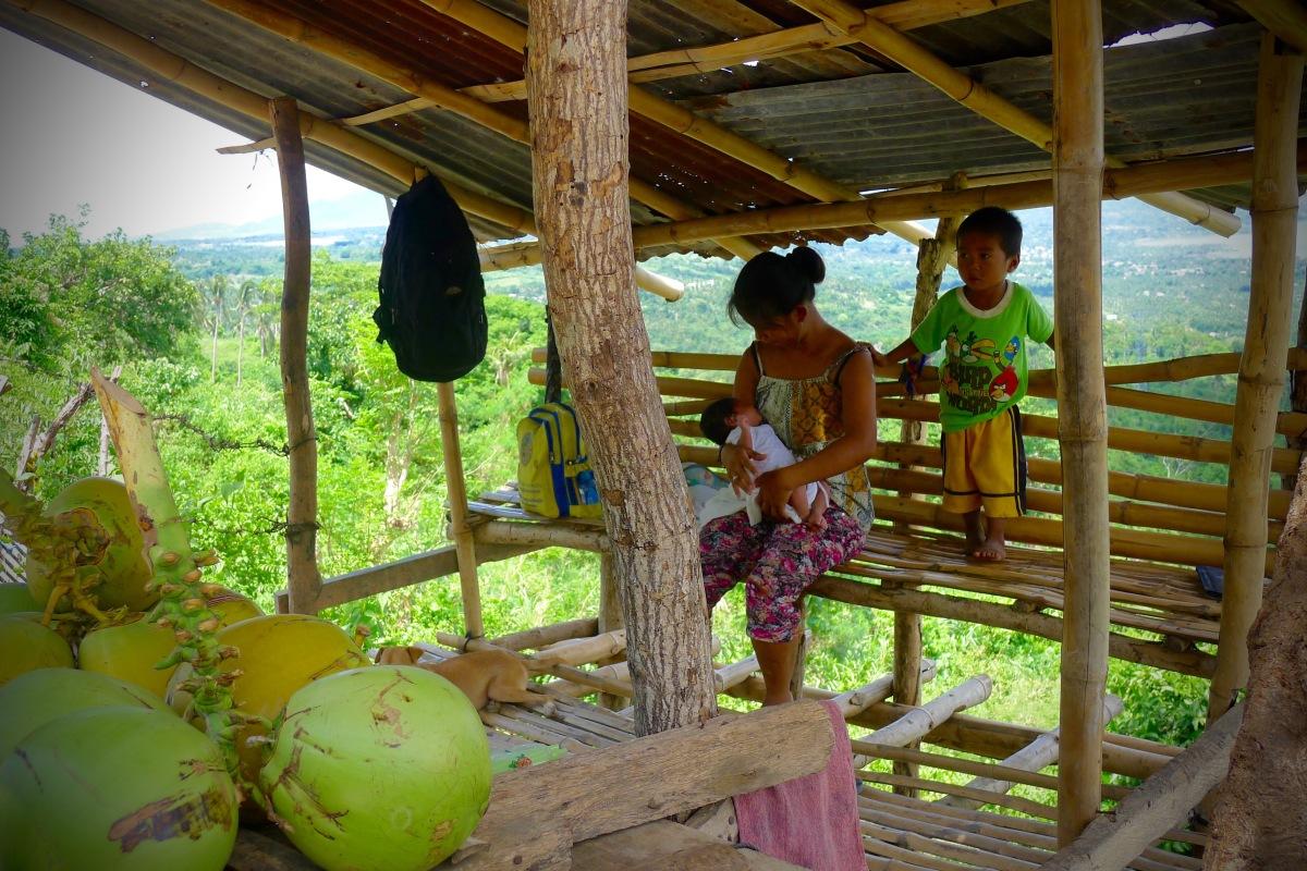 A fruit vendor's family along Ligaya Drive. Talisay, Batangas. Photo: Jboy Gonzales SJ