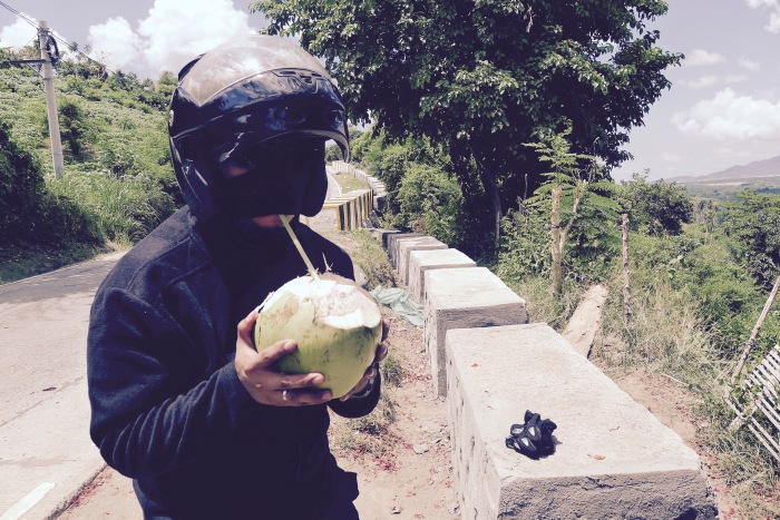 Bok Pioquid, my photography mentor and friend (and motorcycle driver here), refreshes himself with coco water. Photo: Jboy Gonzales SJ
