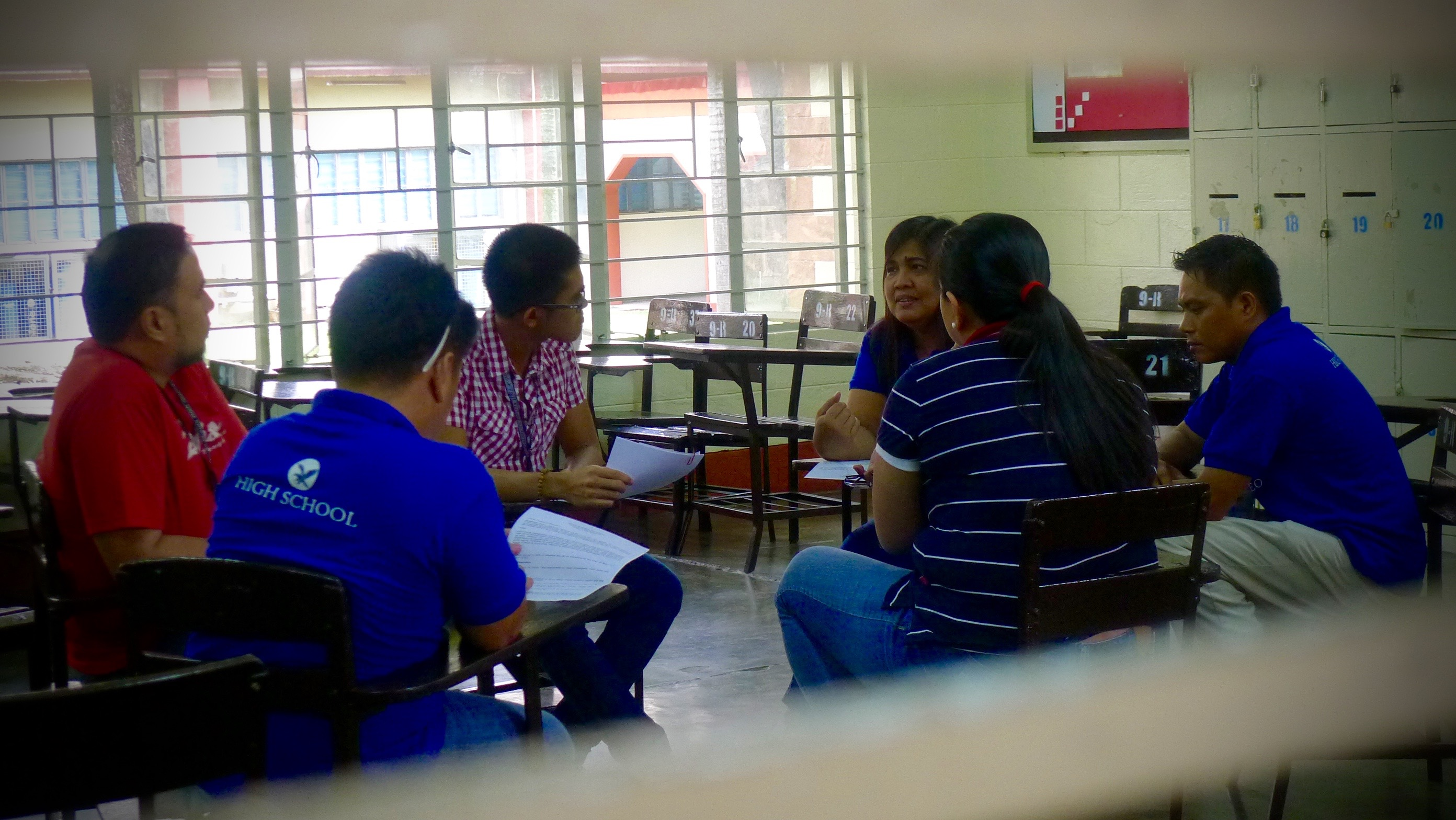 Staff and Maintenance of the Ateneo HS at the Community Spiritual Hour (CSH). Together with the faculty, they pray, reflect and share on certain topics about their life in school. In this photo, Mrs. Letty Coronado opens her heart to her colleagues, facilitated by Paulo (checkered shirt) a Jesuit pre-novice. 3 July 2015 This is part of their formation.