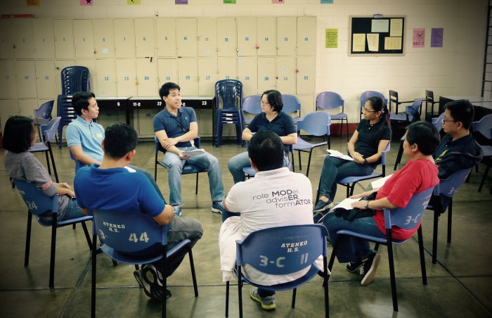 Faculty and Staff members pray and share during the Ateneo HS' Community Spiritual Hour (CSH). In the CSH, we spend an hour every First Friday to reflect on our lives in school. Here, Mr. Franz Santos, Araling Panlipunan subject area coordinator opens his heart to his colleagues. 3 July 2015
