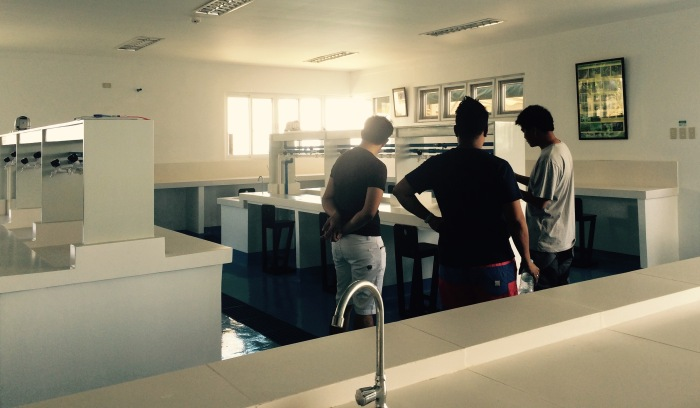 Marine biologist Fra-and Quimpo gives us a tour of the laboratory of the marine station. Photo: Fr. Jboy Gonzales SJ