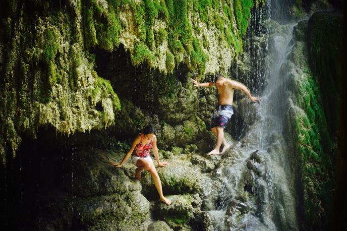 A couple descends the rocks of Tumalog Falls. Oslob, Cebu. 23 August 2015 Photo: Fr. Jboy Gonzales SJ