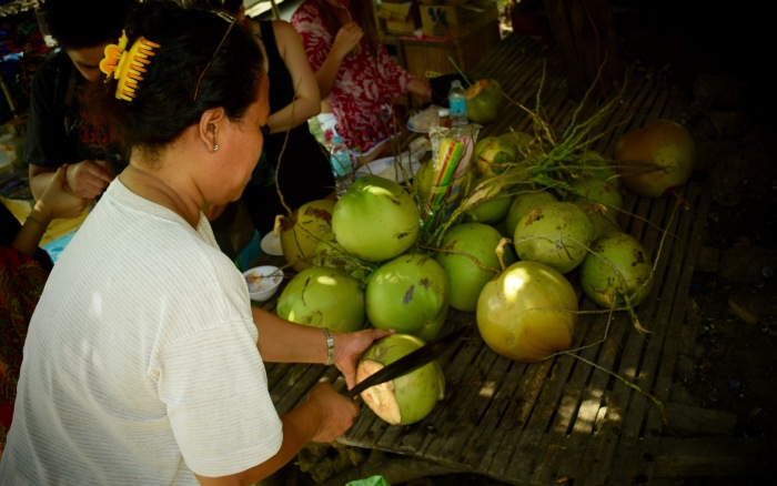 A mother who sells young coconuts to tourists. Oslob, Cebu. 23 August 2015 Photo: Fr. Jboy Gonzales SJ