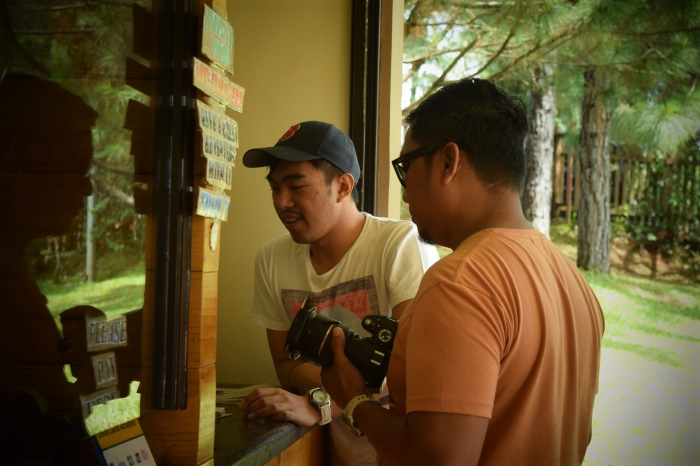 Erick Salonga and Bok Pioquid at the ticket booth. Dahilyan Forest Park. Photo: Fr. JBoy Gonzales SJ