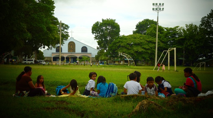 Children taking their lunch together at the Camp Philips Soccer Field. Photo: Fr. Jboy Gonzales SJ