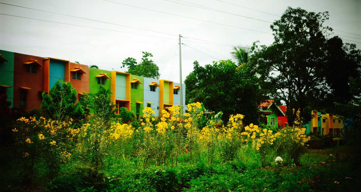 Colorful Gawad Kalinga Houses in Kisolon, Bukidnon. Photo: Fr. JBoy Gonzales SJ