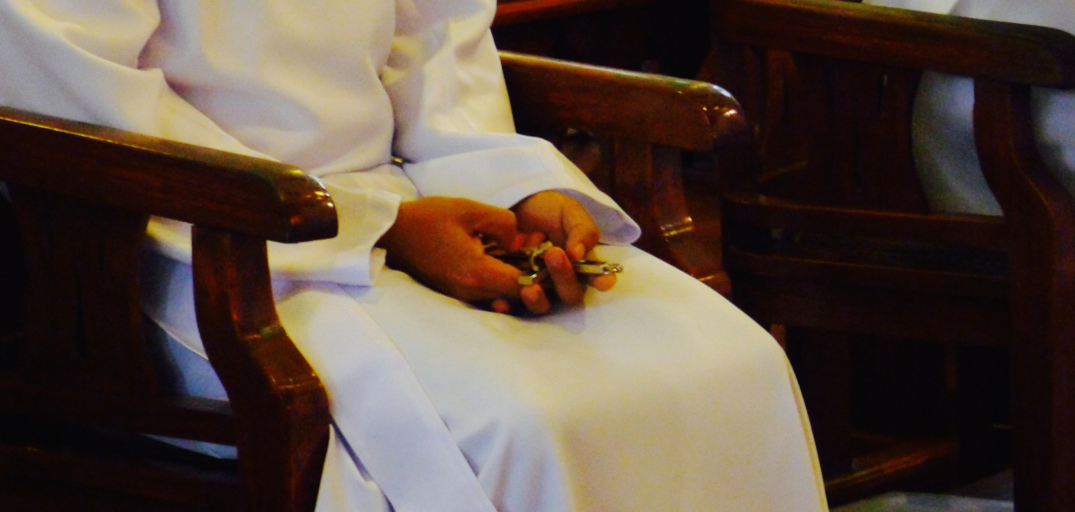 A Jesuit scholastic holds the cross after his first and perpetual vows in the Society of Jesus. Photo: Fr. Jboy Gonzales SJ