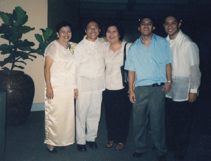 Left to right: My mom, I, Ms. May Flores of XUHS, and my two brothers, Jesse and Jayson.